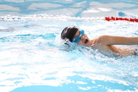 boy swimmer  training in swimming pool