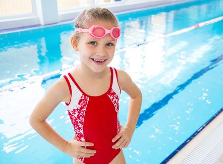 Portrait of little swimmer girl in swimming pool Banco de Imagens