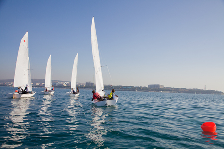 group sailing boats competing in the regatta at sea