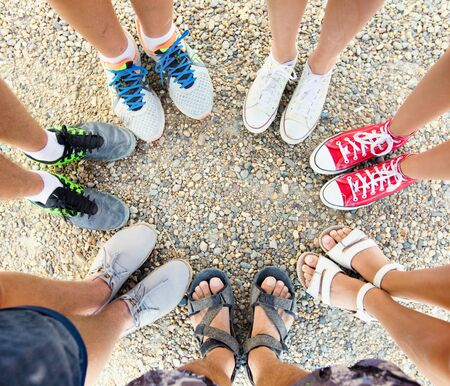 group of teenagers feet in circle
