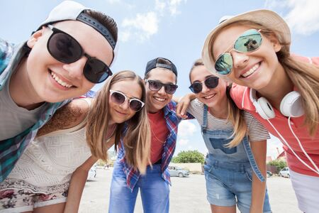 funny portrait of group of teenagers spending time together