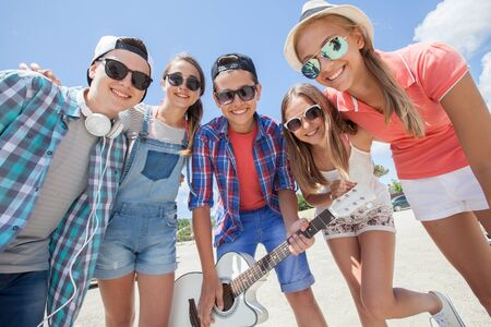 group of teenagers spending time together with guitar 版權商用圖片