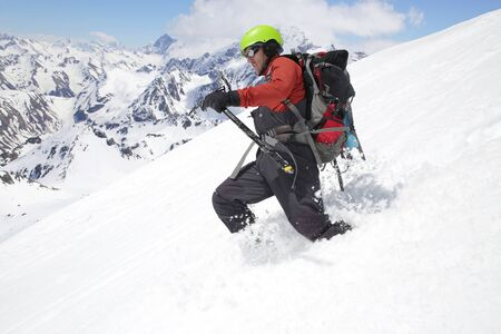 mountaineer  descends from the mountain in the background of the landscape of snowy mountains