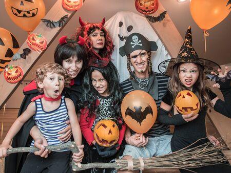 family celebrates halloween at home