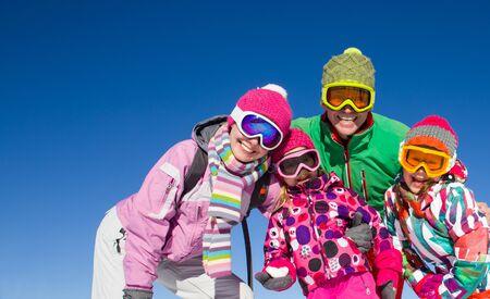 happy family in alpin ski equipment  at the ski resort