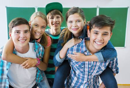 Portrait of a group of students at the school board background
