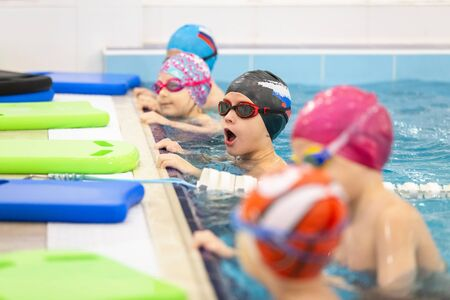 Group of Children training in swimming pool