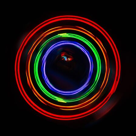 amazing abstract photo of colorful lights blurry in a circular motion on a dark background