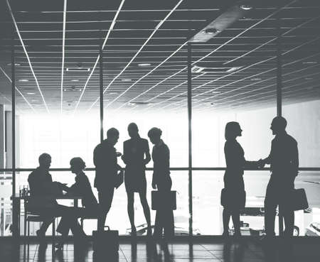 Group ofl silhouettes of businesspeople comunications background business center Stock fotó