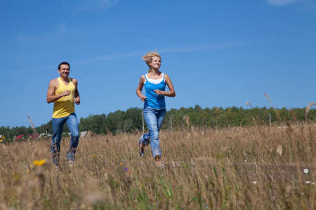 beautiful middle-aged people jogging in nature