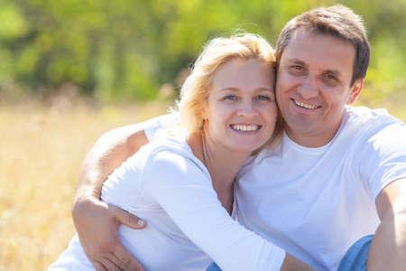 middle aged couple enjoying life together on nature