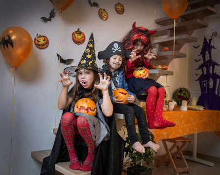 Children playing in the attic at home on a halloween holiday