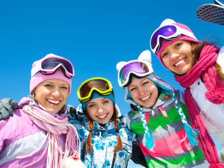 Group of girlfriands on ski holiday in mountains