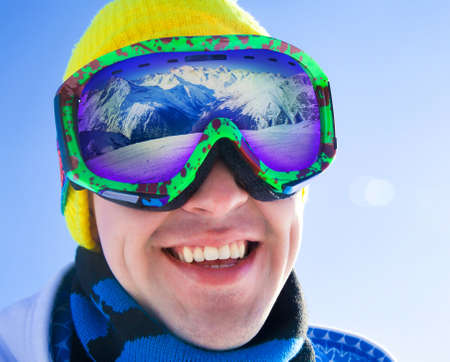 Portrait of a young man in a ski mask with reflection group of friends