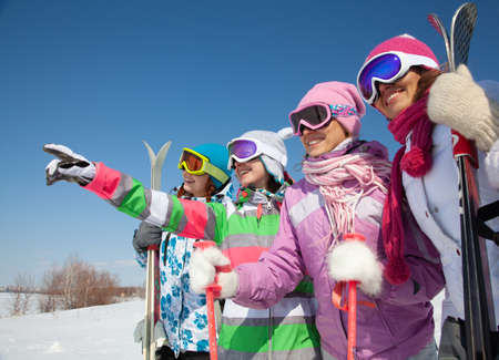 group of girlfriends have a good time in winter resort
