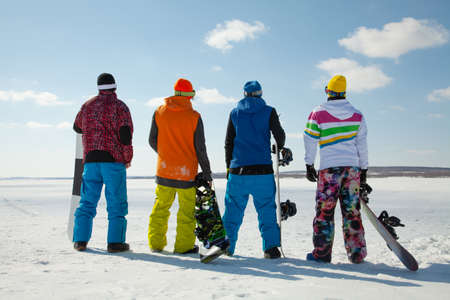 Group of snowboardesr stats front the mountaint along the road extreme