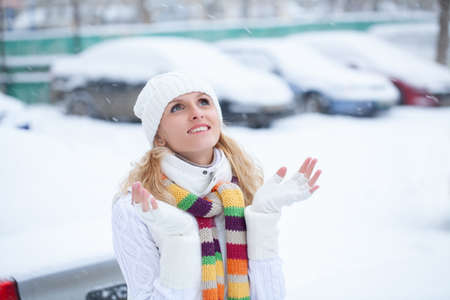 Portrait of young woman in winter clothing in snowy park