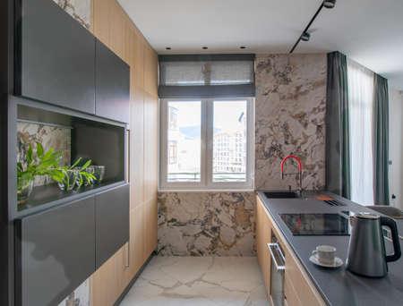 kitchen interior with window in modern apartment