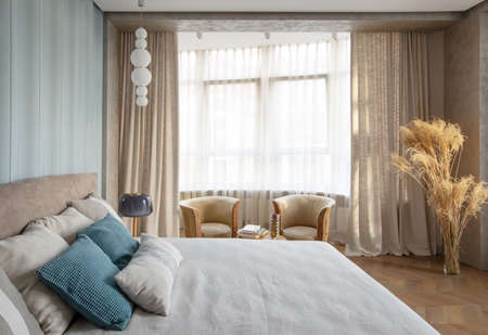 modern interior of bedroom with armchairs and textiles decor Standard-Bild