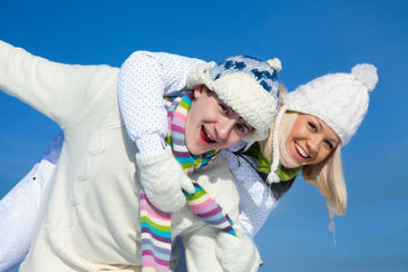 Attractive young couple having fun winter time