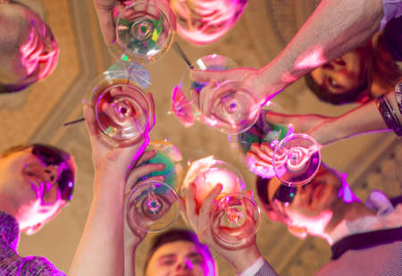 cheerful young company drinking in a nightclub