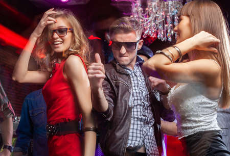 Group of young people dancing at the disco club