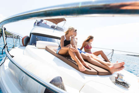 group of young people enjoying a yacht holiday in the sea Stockfoto