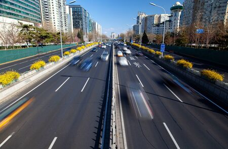 Beijing road by Chinese buildings under blue sky