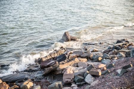 Waves hitting the rocky shore of Lake Superior Stock Photo