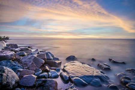 long lake: Rocky shore of Lake Superior during dusk time