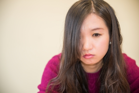 low self esteem: Sad young woman looking depressed