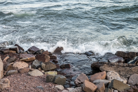 Waves hitting the rocky shore of Lake Superior Stock Photo
