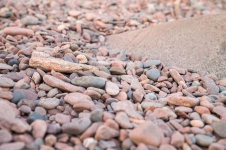 Different type of rocks on a lake shore photo