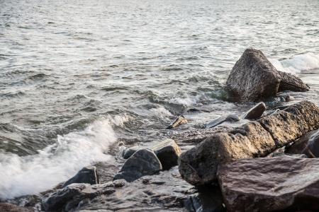 Waves hitting the rocky shore of Lake Superior photo