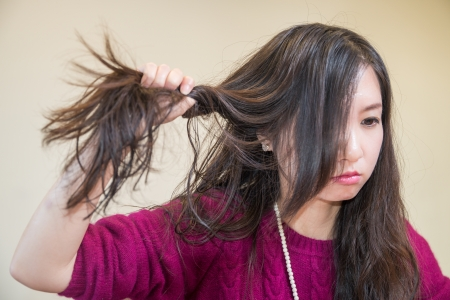 chaos: Young woman pulling her hair looking frustrated