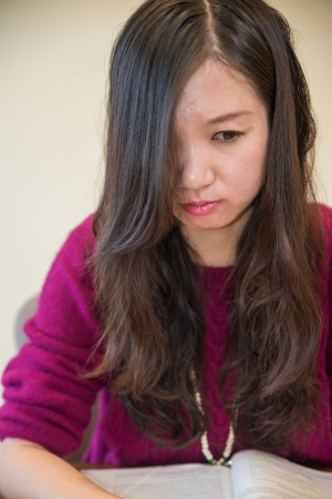 low self esteem: Sad young woman looking depressed with open book