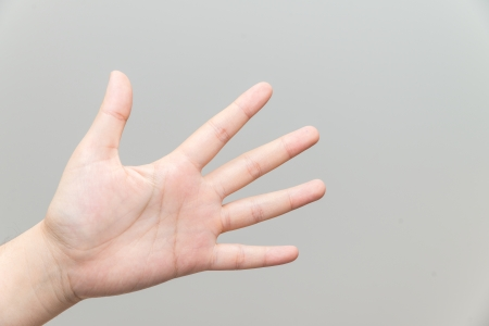 grabbing at the back: Human hand with open palm playing rock Stock Photo