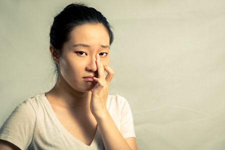 Portrait of young woman crying desperately, with fashion tone and background Stock Photo