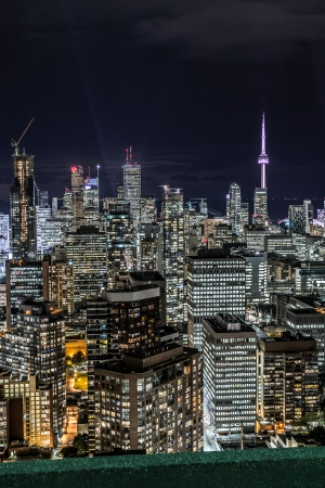 Full view of downtown Toronto at night with glamour lights viewing from a balcony photo