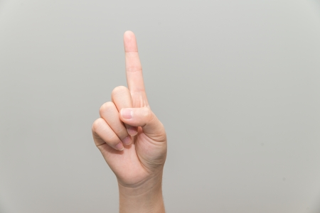 Human hand with one finger sticking up