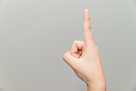 grabbing at the back: Human hand with one finger sticking  Stock Photo