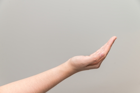recieve: Human hand with open palm ready to recieve Stock Photo