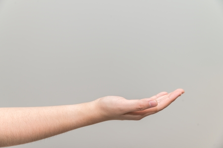 Human hand with open palm ready to recieve photo