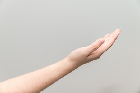 grabbing at the back: Human hand with open palm ready to receive  Stock Photo