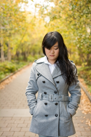 low self esteem: Close up portrait of attractive young girl alone on a road looking depressed Stock Photo
