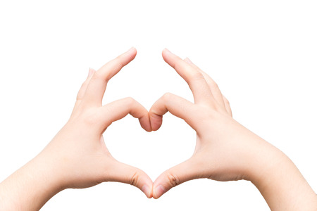 Human hands making a heart shape on light gray background Stock Photo