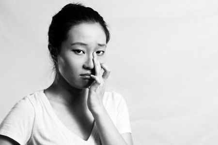 Portrait of pretty girl crying desperately, black and white style photo