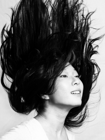 flicking: Portrait of beautiful young woman flicking her hair and posing, black and white style