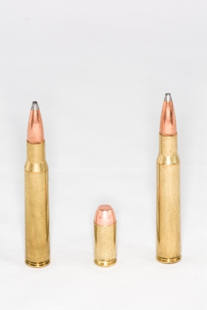 A few rifle and hand gun bullets on white background with details photo