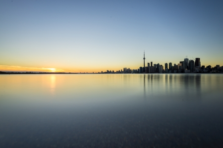 Sunset next to downtown Toronto during early winter time photo